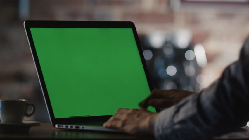 Man using Laptop with Green Screen in Cafe. Shot on RED Cinema Camera in 4K (UHD). | Shutterstock HD Video #10026578