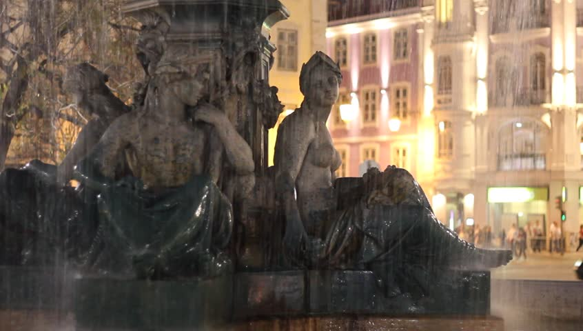 Romantic scene in night Lisbon : Fountain on the Rossio square with running water and electric city lights on the background.   | Shutterstock HD Video #10041620