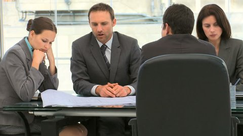 Business people working together on a document during a meeting in an office