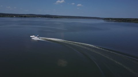 Luxury motor yacht boat moving on a river