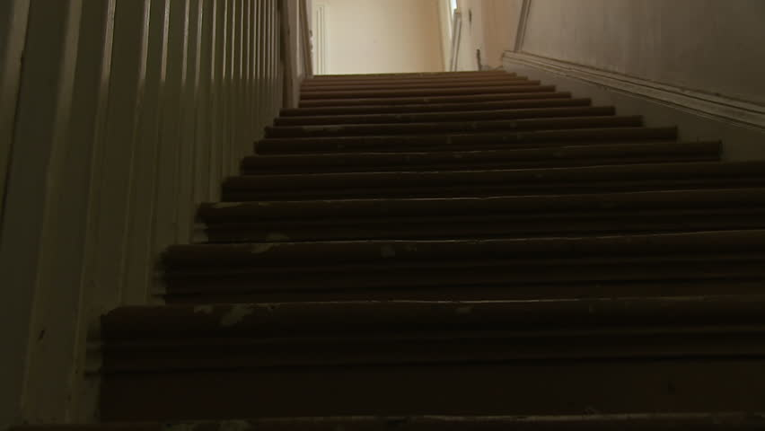 A worms eye view shot of stairs.   Shutterstock HD Video #1006574320
