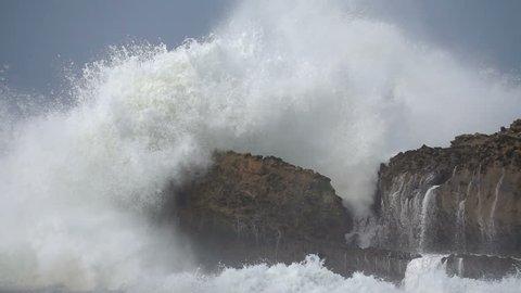 Extreme wave crushing coast slowmo, Big wave. Large Ocean Wave,Awesome power of giant waves breaking over dangerous rocks