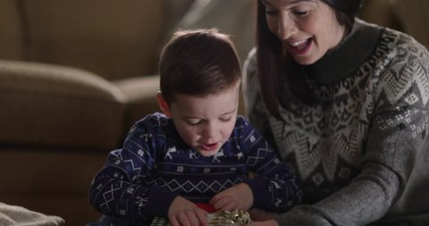 Mother and Son unwrapping Christmas gifts