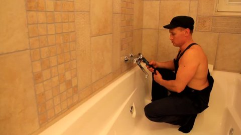 Plumber repairing faucet inside bath  Adult film parody. Plumber and sexy girl: nurse, maid  blonde. Funny movie