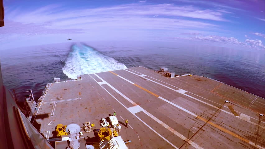 CIRCA 2010s - Aircraft carrier USS Gerald R. Ford (CVN 78) conducts flight operations with jets landing.