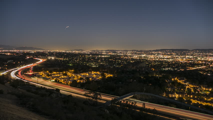Sunset to night time lapse view of route 118 freeway near Topanga Canyon Bl in the San Fernando Valley area of Los Angeles, California.
