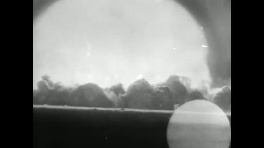 CIRCA 1940s - Atomic bomb blast footage of Hiroshima and Nagasaki in 1945.