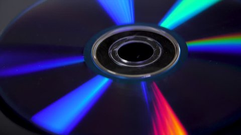 Isolated CD in black background. Colorful abstract background. Close up of CD. DVD Disc on black background - landscape format
