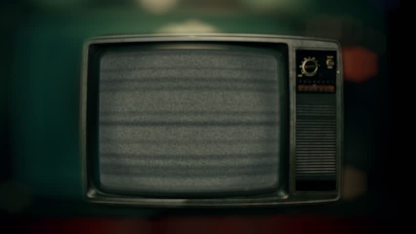 Retro Television Static Noise Zoom In. Zoom in old Television screen with static noise interference. Vintage Style | Shutterstock HD Video #1006771300