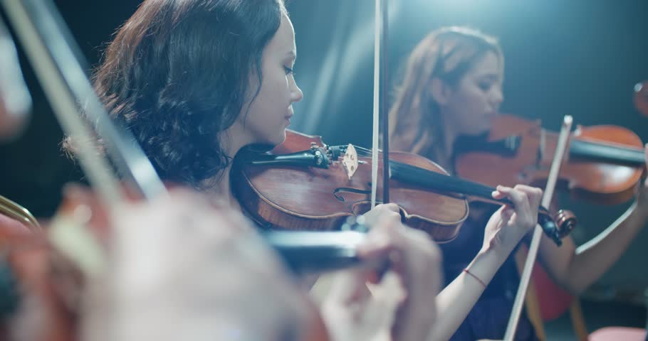 Symphony orchestra performance, close-up of stringed instruments at work | Shutterstock HD Video #1006776520