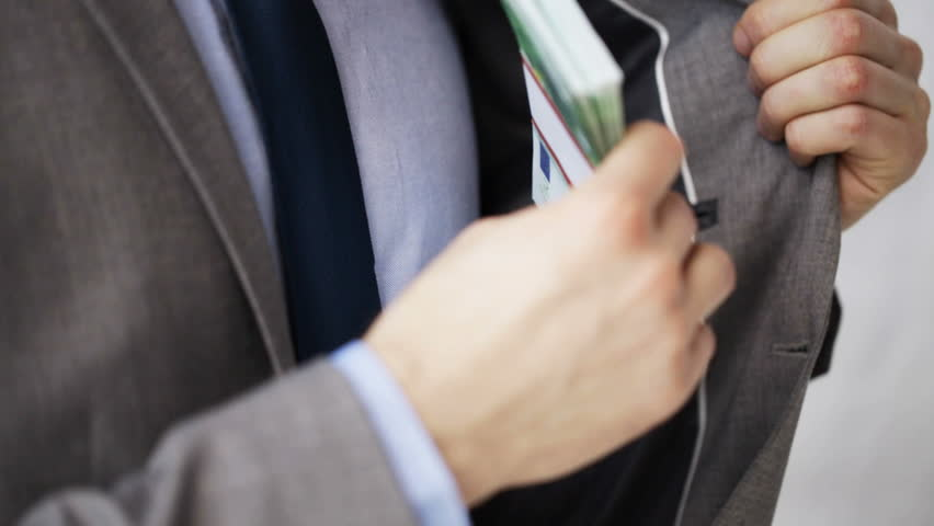 people, business, corruption, bribery and fraud concept - close up of businessman hands taking money bribe and purring it to his jacket pocket
