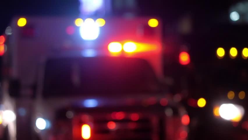 Blurred shot of ambulance with emergency lights flashing