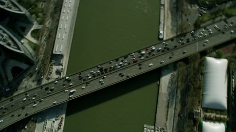 4K Aerial view of traffic crossing on a bridge across the River Seine in Paris