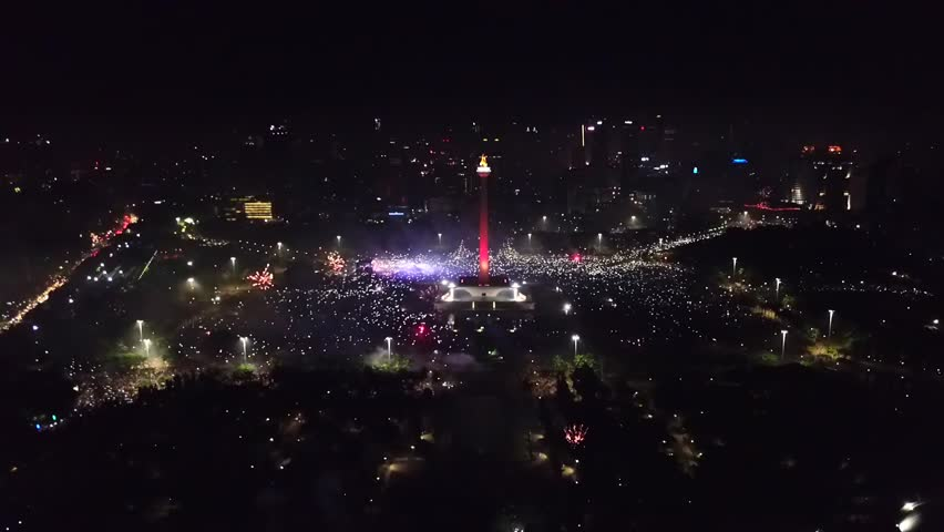 Beautiful aerial view of 2018 New Year eve party in National Monument with sparkle fireworks, Central Jakarta, Indonesia