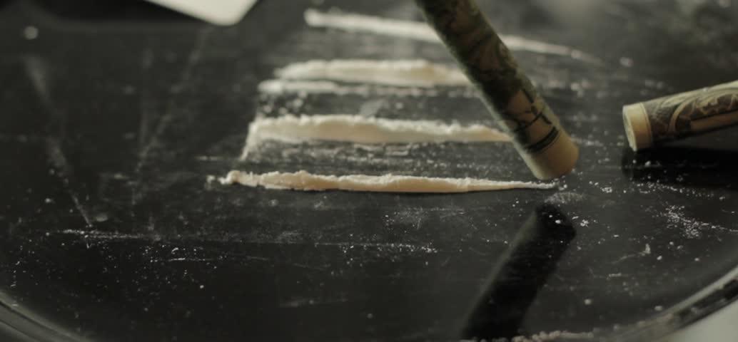 Snorting cocaine, paraphernalia, drug use