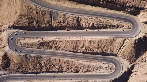 Desert road - Aerial footage of traffic going up and down a  serpentine mountain road