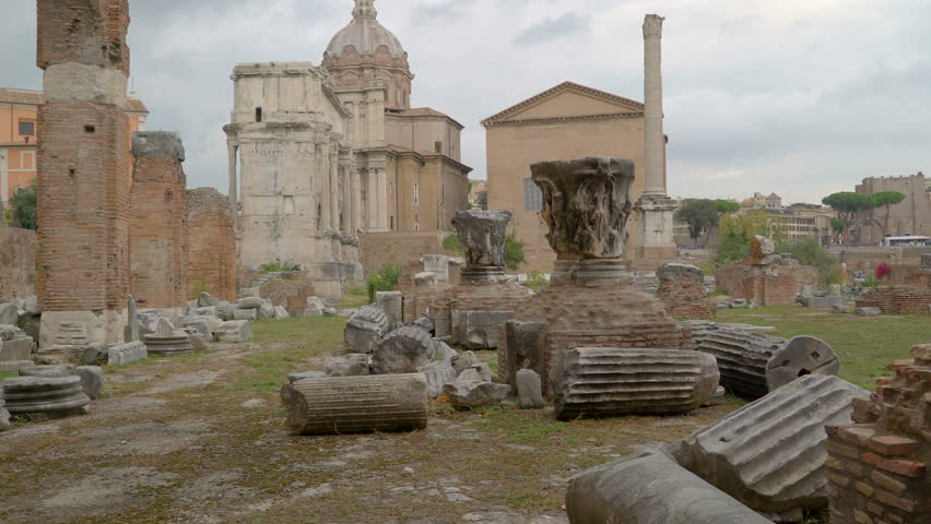 Big rubbles and ruines on the ground in the Roman Forum with lots of bricks and walls scattered around in Italy