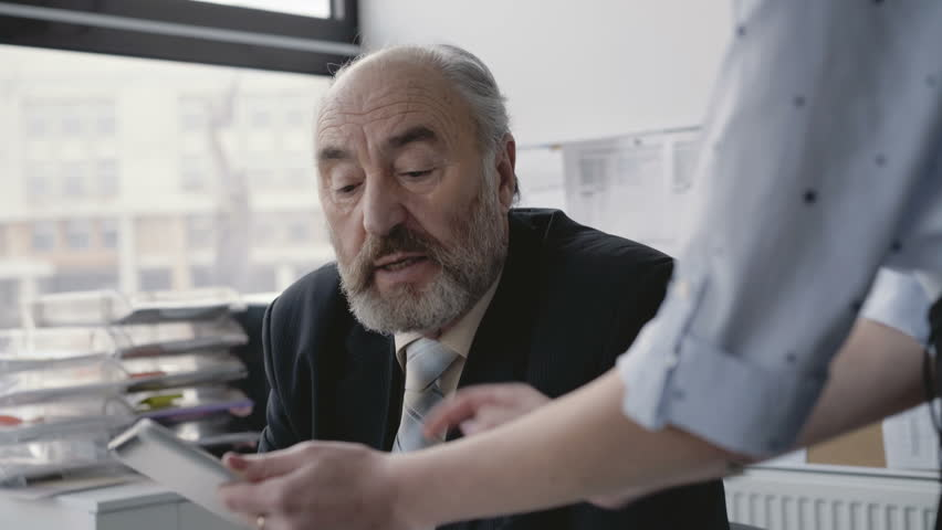 Office girl communicates with boss and uses tablet. 4K. | Shutterstock HD Video #1006880500