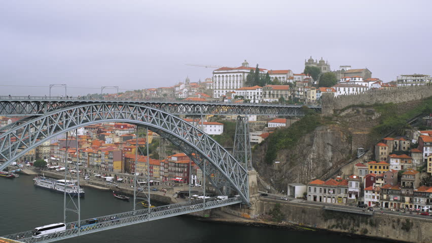Aerial view of beautiful steel bridge Ponte Dom Luis I over the river Douro in Oporto, Portugal.