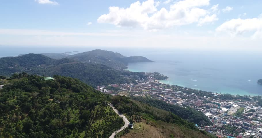 PHUKET ,THAILAND - 2018 :Big Buddha statue was built on a hilltop. A view of Kata beach and Karon beach on the exotic island of Phuket.   Shutterstock HD Video #1006981510