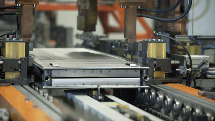 Modern robotic Production of heating radiators in Modern Factory | Shutterstock HD Video #1006990480