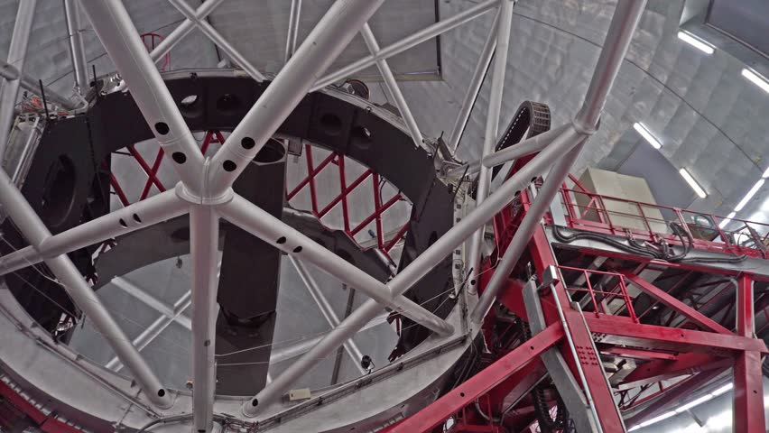 Giant mirror of astronomical telescope being rotated  #1007002480