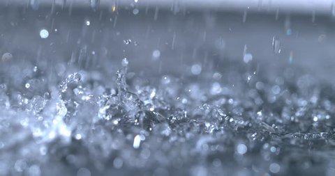 Heavy rain slow motion close up shot on Phantom Flex 4K