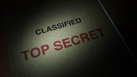 Spying and finding a Top Secret File under torch light.
