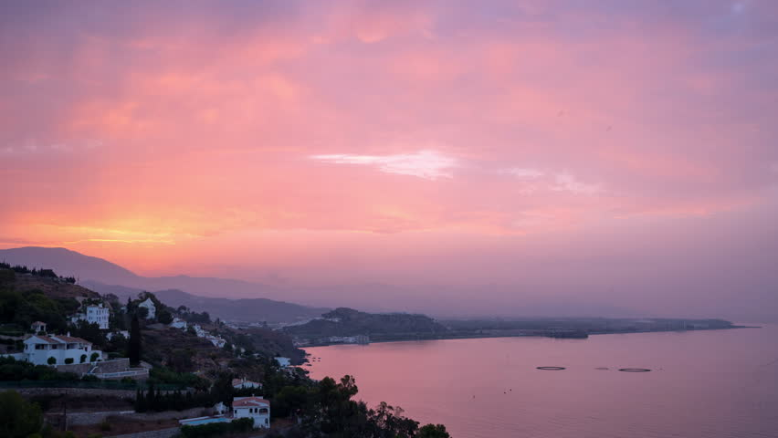 Sunrise timelapse over the Salobreña city coastline in Costa Tropical in Granada, Spain. | Shutterstock HD Video #1007026810