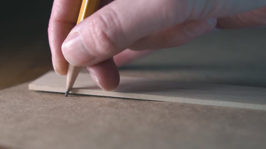 The pencil breaks when drawing a line along the ruler. Slow motion.