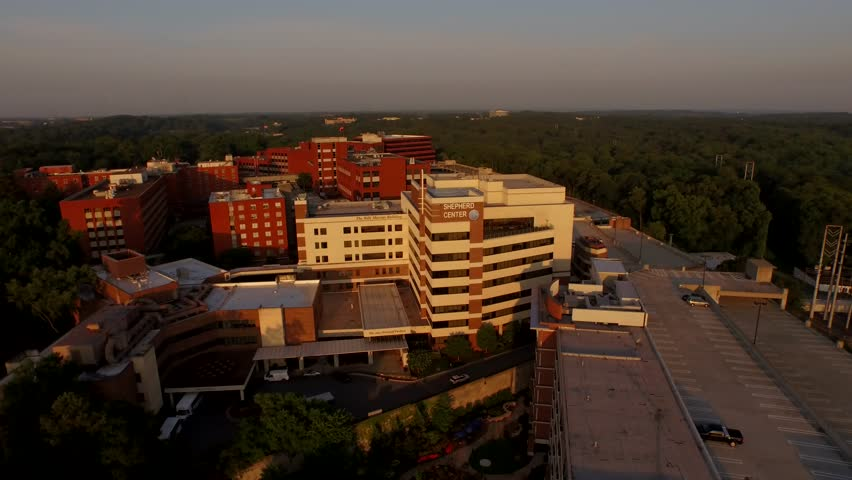 Drone shot circling around a healthcare complex in Atlanta known for treating spinal cord injuries | Shutterstock HD Video #1007043400