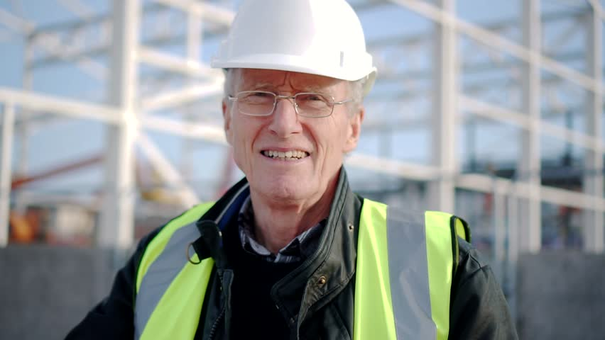 Portrait Of Experienced Construction Engineer Onsite, Senior Man Building.