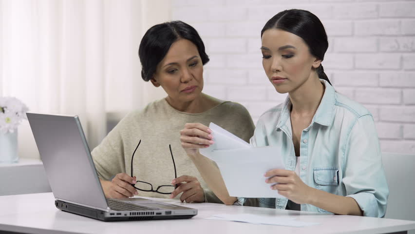 Family reading bill with big sum of money, unpleasant surprise, personal loan | Shutterstock HD Video #1007101540