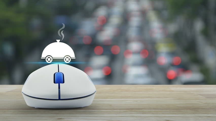Restaurant cloche flat icon with wireless computer mouse on wooden table over blur of rush hour with cars and road, Food delivery concept