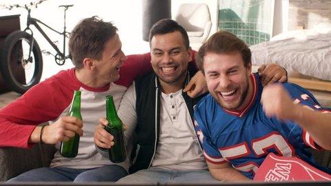 Emotional scene of male fans celebrating