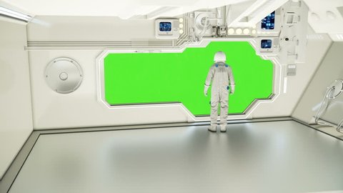 An astronaut on a spaceship watching the universe. Green screen.