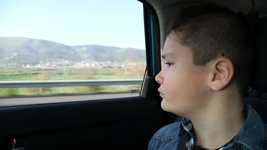 Little boy travelling in car and looking through the window   Shutterstock HD Video #1007173690