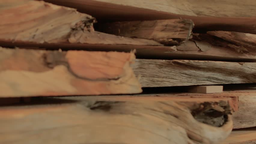 Slow slide shot of wooden slabs pile. Carpentery. | Shutterstock HD Video #1007184370