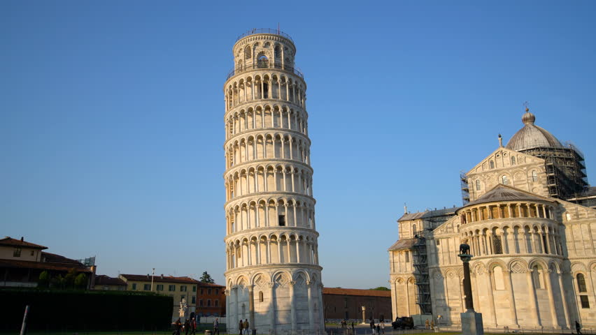 Leaning Tower of Pisa in Pisa, Italy. Leaning Tower of Pisa known worldwide for its unintended tilt , travel destination of Italy. The bell tower is situated behind The Pisa Cathedral.   Shutterstock HD Video #1007186920