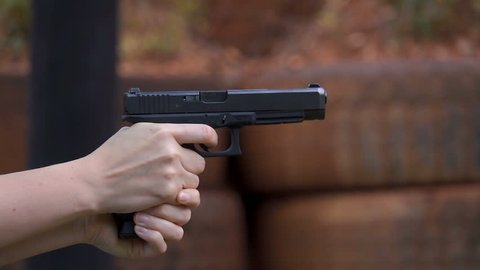 Female hands shooting 9mm pistol closeup slow motion 250 fps