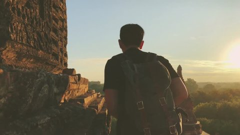 Young tourist walking on side of the pagoda in Bagan, Mandalay region, Myanmar. Tourism and Travel footage concept
