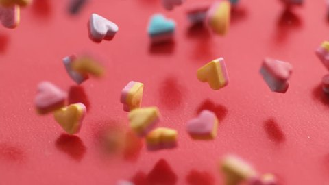 Valentine's Day heart shaped candy falling and bouncing in slow motion.  Shot on Phantom Flex 4K.