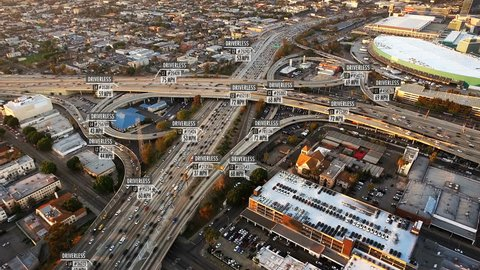 Driverless or autonomous car aerial view. Traffic passing by a highway. Plate number, miles per hour and fake ID number displaying. Future transportation. Artificial intelligence. Self driving.