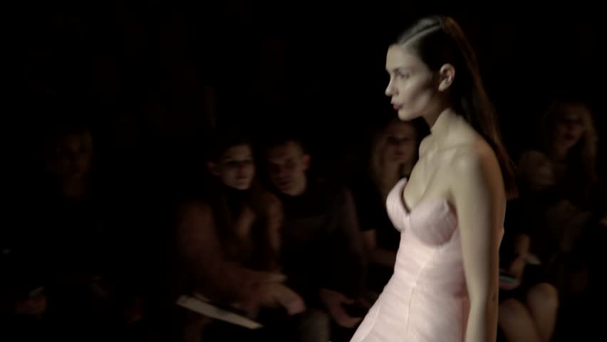 KYIV, UKRAINE - FEBRUARY 6, 2017. Ukrainian Fashion Week. Catwalk during fashion show. Girls model the dresses on the catwalk | Shutterstock HD Video #1007306260