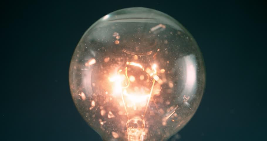 Lightbulb exploding super slow motion shot with Phantom Flex at 1000 frames per second | Shutterstock HD Video #1007333020