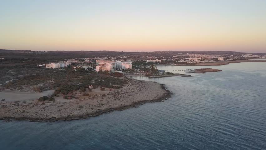 Aerial footage Ayia Napa, Cyprus - Beautiful sunset in Nissi Beach