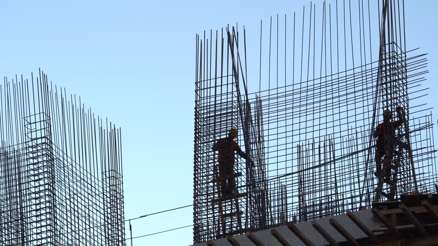 CONSTRUCTION WORKER SILHOUETTE  working with concrete iron near sunset | Shutterstock HD Video #1007402440