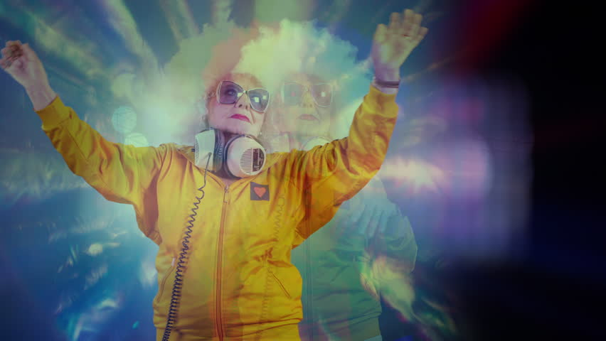 An amazing grandma disco dancer and dj, older lady partying in a hypnotic colourful disco setting. | Shutterstock HD Video #1007433400