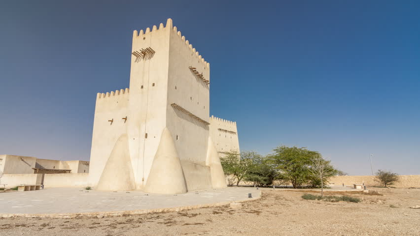 Barzan Towers timelapse hyperlapse, watchtowers in Umm Salal Mohammed near Doha - Qatar, the Middle East. Blue sky at sunny day