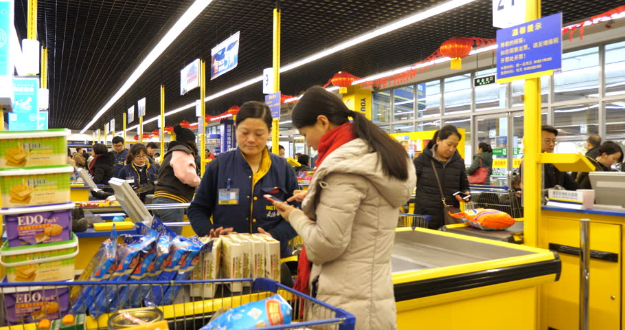 February 12, 2018 in Chengdu, Sichuan China . people settle the bill with mobile phone in the Metro supermarket, people use mobile phone to pay almost everything in China now days,mobile payment